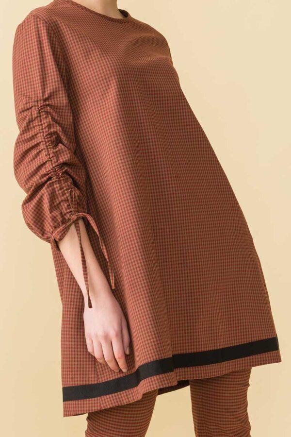abito invernale a quadretti con manica arricciata